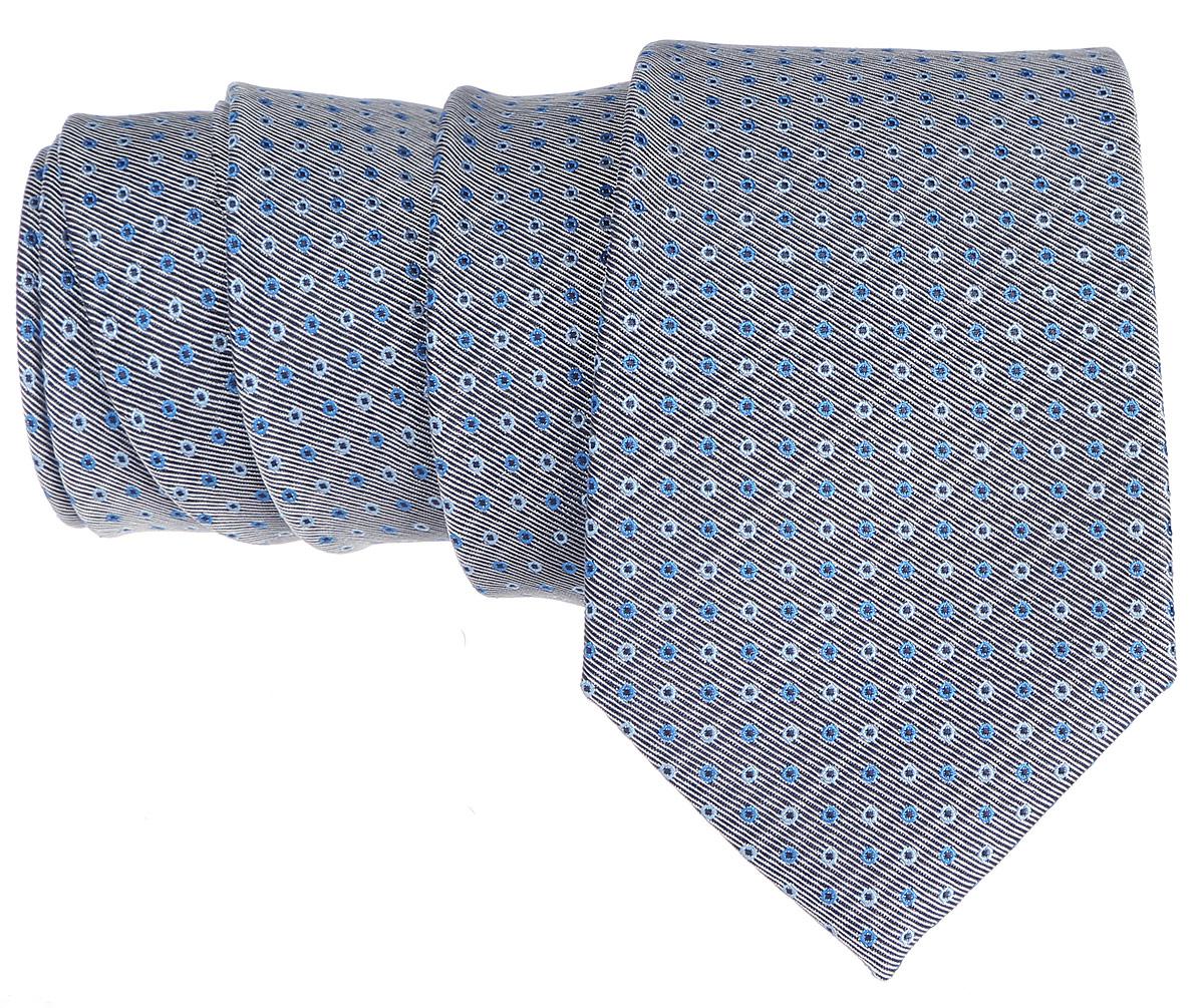 Галстук. 12.01850612.018506Стильный галстук BTC станет отличным завершающим штрихом вашего образа. Этот модный аксессуар порадует вас высоким качеством исполнения и современным дизайном. Изделие полностью выполнено из качественного полиэстера. Галстук оформлен оригинальным принтом. Такой оригинальный галстук подойдет как к повседневному, так и к официальному наряду, он позволит вам подчеркнуть свою индивидуальность и создать свой неповторимый стиль.