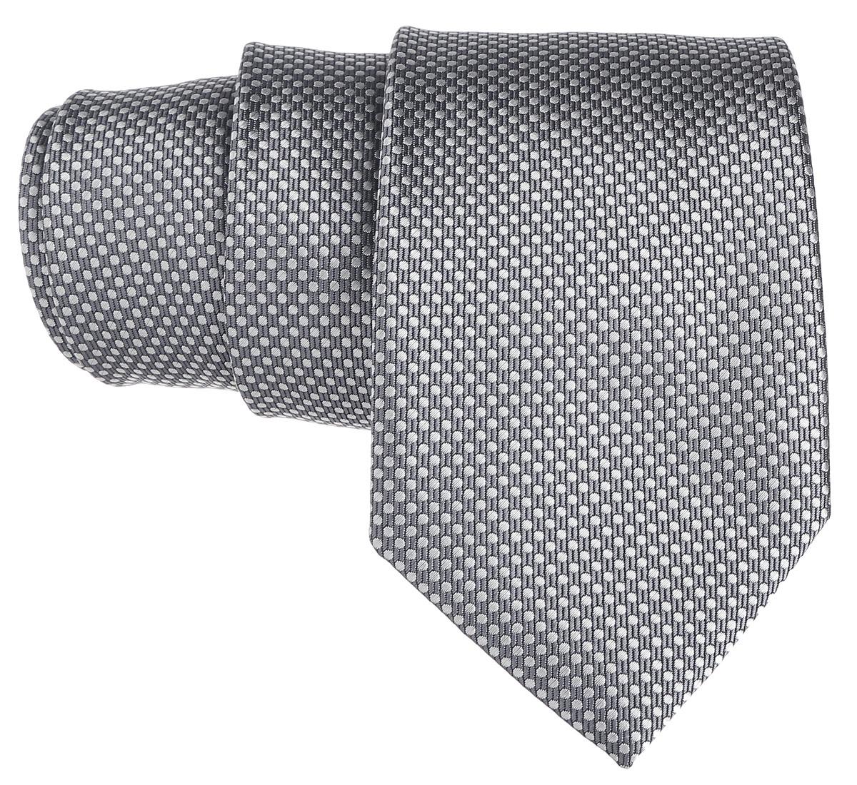 Галстук. 12.01409912.014099Стильный галстук BTC станет отличным завершающим штрихом вашего образа. Этот модный аксессуар порадует вас высоким качеством исполнения и современным дизайном. Изделие полностью выполнено из качественного полиэстера. Галстук оформлен оригинальным принтом. Такой оригинальный галстук подойдет как к повседневному, так и к официальному наряду, он позволит вам подчеркнуть свою индивидуальность и создать свой неповторимый стиль.