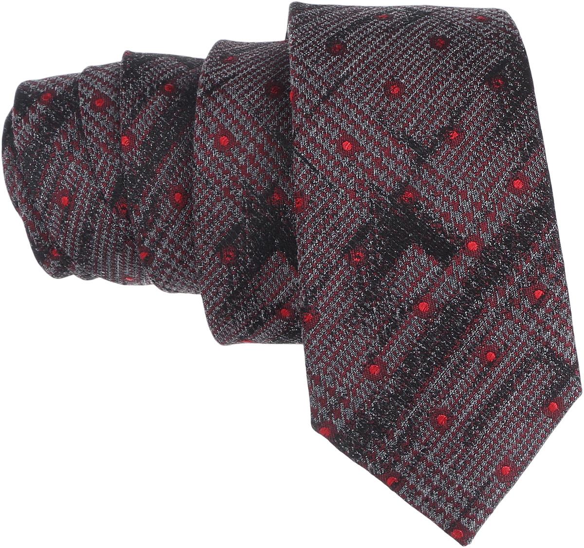 Галстук. 12.01546912.015469Стильный галстук BTC станет отличным завершающим штрихом вашего образа. Этот модный аксессуар порадует вас высоким качеством исполнения и современным дизайном. Изделие полностью выполнено из качественного шелка. Галстук оформлен оригинальным принтом. Такой оригинальный галстук подойдет как к повседневному, так и к официальному наряду, он позволит вам подчеркнуть свою индивидуальность и создать свой неповторимый стиль.