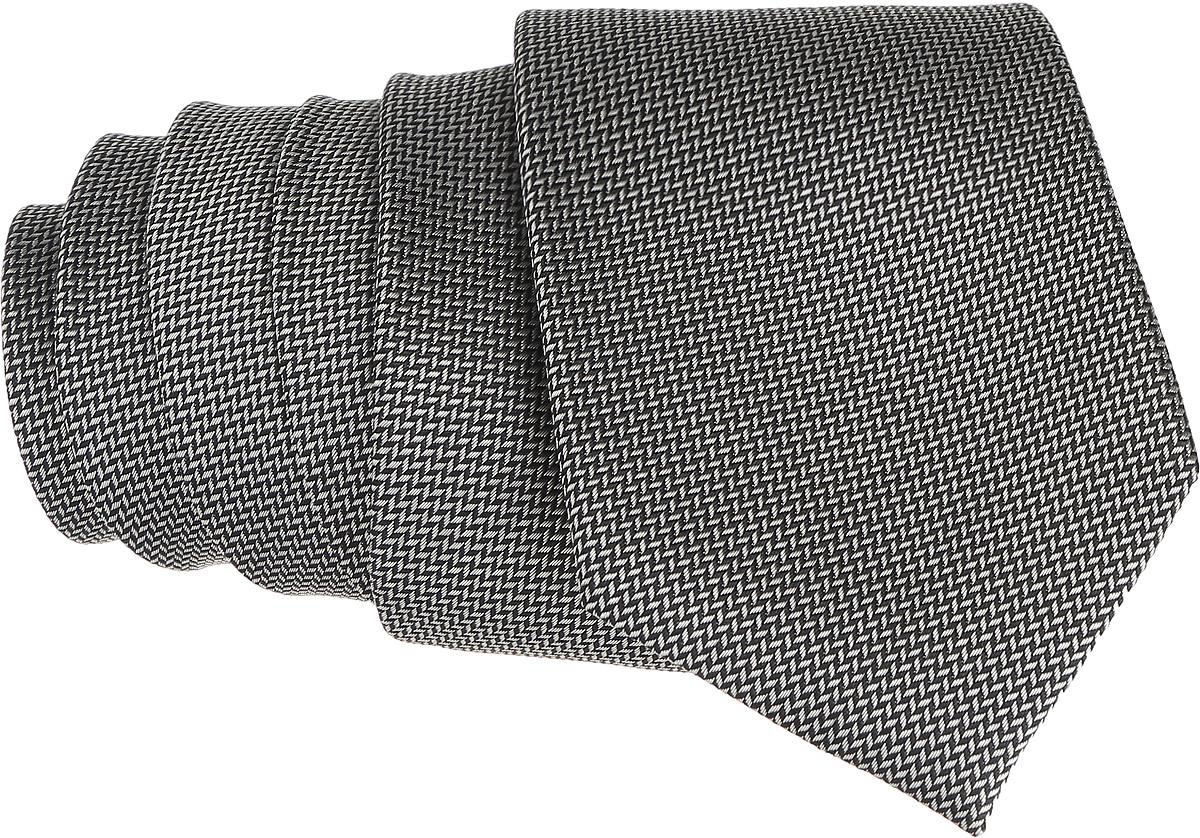 Галстук. 12.01410012.014100Стильный галстук BTC станет отличным завершающим штрихом вашего образа. Этот модный аксессуар порадует вас высоким качеством исполнения и современным дизайном. Изделие полностью выполнено из качественного шелка. Галстук оформлен оригинальным принтом. Такой оригинальный галстук подойдет как к повседневному, так и к официальному наряду, он позволит вам подчеркнуть свою индивидуальность и создать свой неповторимый стиль.