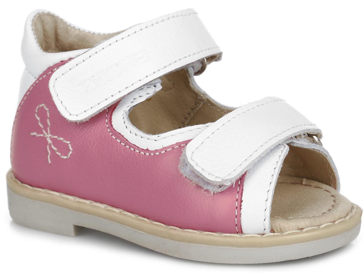 Сандалии для девочки. 10599-1810599-18Прелестные сандалии от Зебра придутся по душе вашей девочке и идеально подойдут для повседневной носки в летнюю погоду! Модель, выполненная из натуральной кожи, сбоку оформлена вышитым бантиком, вдоль ранта - крупной прострочкой. Ремешки с застежками- липучками, оформленные тисненым названием бренда, обеспечивают надежную фиксацию модели на ноге. Внутренняя поверхность и стелька из натуральной кожи комфортны при ходьбе. Стелька дополнена супинатором, который обеспечивает правильное положение стопы ребенка при ходьбе и предотвращает плоскостопие. Широкий, устойчивый каблук, специальной конфигурации каблук Томаса, продлен с внутренней стороны до середины стопы, чтобы исключить вращение (заваливание) стопы вовнутрь. Подошва с рифлением гарантирует отличное сцепление с любой поверхностью. Прелестные сандалии - незаменимая вещь в гардеробе каждой девочки!