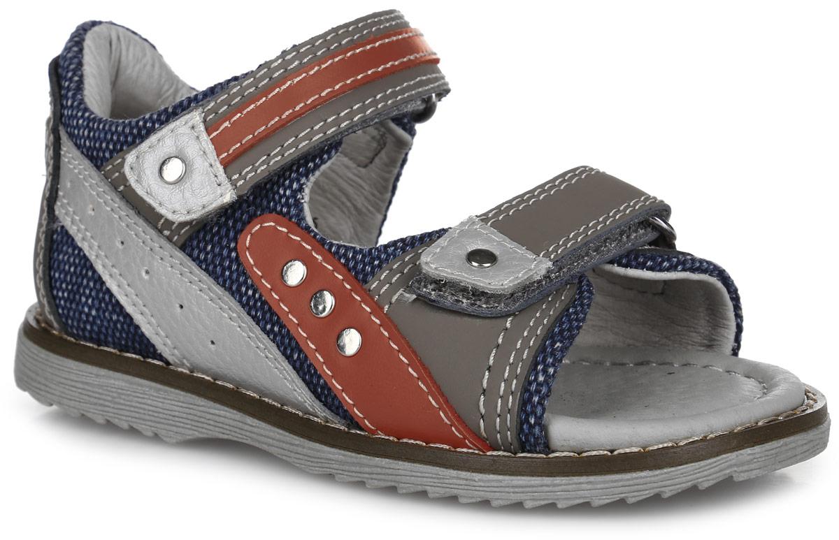 Сандалии для мальчика. 9569-109569-10Модные сандалии от Зебра придутся по душе вашему мальчику. Модель, выполненная из натуральной кожи и текстиля, оформлена контрастной прострочкой, сбоку - декоративной перфорацией, сбоку и на ремешках - металлическими заклепками, вдоль ранта - крупной прострочкой. Ремешки с застежками-липучками обеспечивают надежную фиксацию модели на ноге. Внутренняя поверхность и стелька из натуральной кожи обеспечат комфорт. Стелька дополнена супинатором с перфорацией, который обеспечивает правильное положение стопы ребенка при ходьбе и предотвращает плоскостопие. Подошва с рифлением гарантирует отличное сцепление с любой поверхностью. Стильные сандалии - незаменимая вещь в гардеробе каждого мальчика!