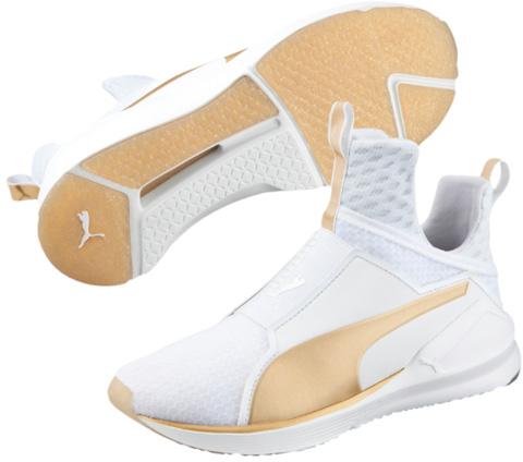 Кроссовки женские. 1891920118919201Кроссовки Fierce входят в линейку моделей PUMA, вдохновлённую стилем и творчеством Рианны. Функциональные элементы этой обуви удачно сочетаются со сверхмодным силуэтом и оригинальными декоративными деталями. Конструкция верха обеспечивает максимальную поддержку стопы и непревзойденный комфорт. Дополнительные стабилизаторы с боков и по средней линии подошвы гарантируют устойчивость при любых поворотах и разнонаправленных движениях. К сезону «осень-зима 2016» мы подготовили особую версию модели – ЗОЛОТЫЕ Fierce – с новаторской резиновой внешней подошвой, сверкающей золотыми искрами, и золотистыми деталями верха, изготовленного из высококачественных материалов.