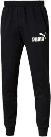 Брюки спортивные мужские. 8382640183826401Модель декорирована прорезиненным логотипом Puma. Среди других отличительных особенностей изделия - пояс из его основного материала с продернутыми затягивающимися шнурами, карманы в швах, нашитая сверху задняя кокетка для лучшей посадки по фигуре, а также отделка манжет по низу штанин трикотажем в резинку.