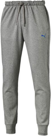 Брюки спортивные838377_03Спортивные брюки Puma Puma Hero Pants Fl Cl выполнены из плотного трикотажа, мягкая внутренняя отделка. Модель декорирована графическим рисунком, сочетающим печать высокой плотности с прорезиненными элементами и деталями из светоотражающего материала. Она изготовлена из высокофункционального материала dryCELL в варианте dryFLEECE, который отводит влагу, поддерживает тело сухим, сохраняет тепло и гарантирует максимальный комфорт. Среди других отличительных особенностей изделия – эластичная подкладка под пояс с символикой Puma жаккардового переплетения с внутренними затягивающимися шнурами, удобные карманы в швах, манжеты внизу штанин, декоративные лампасы, а также нашитая сверху задняя кокетка для лучшей посадки по фигуре.