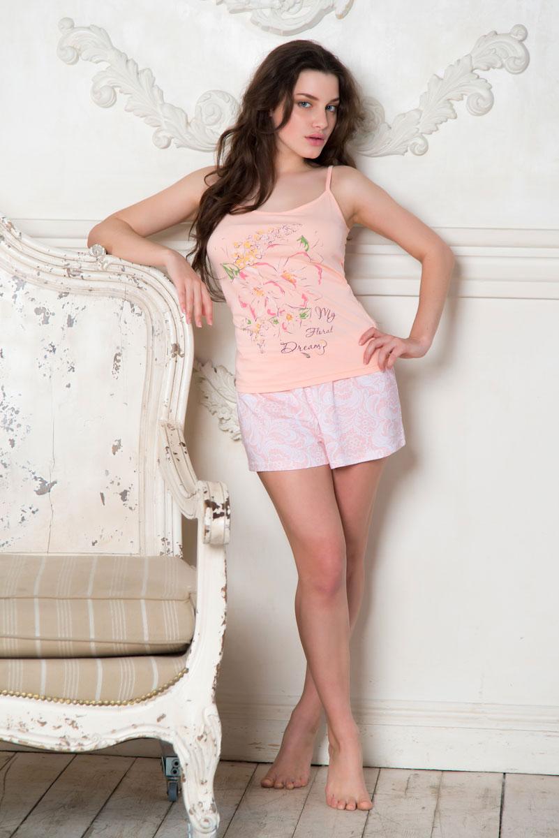 SS16-PG-04Женская пижама Santi включает в себя майку и шорты. Пижама изготовлена из натурального хлопка. Майка на узких бретельках, не регулируемых по длине, оформлена крупным цветочным принтом. Свободные шорты с широкой эластичной резинкой в поясе украшены принтом с изображением кружевного узора. Домашняя одежда торговой марки Santi уже давно зарекомендовала себя на российском рынке. Красивая, комфортная одежда для дома, разработанная специально для женщин всех возрастов. Одежда торговой марки Santi производится из высококачественного 100% хлопка, а благодаря тому, что производство располагается на российской фабрике, производители смогли не только удержать, но и снизить уровень цен.