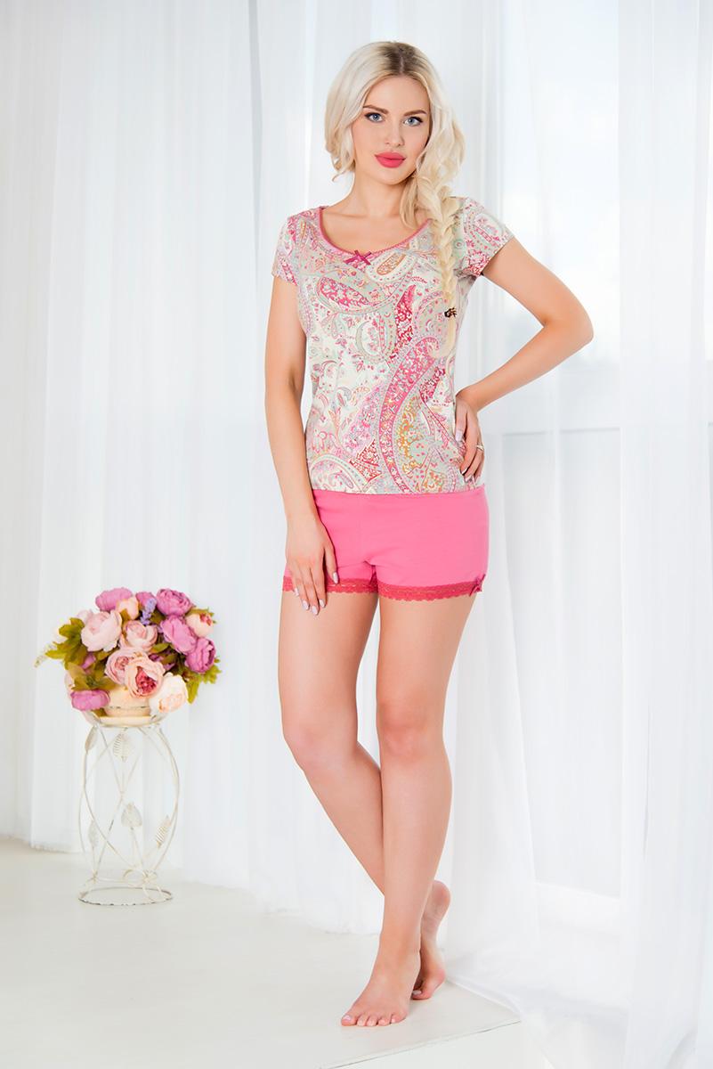 SS16-MCUZ-293Женская пижама Mia Cara включает в себя футболку и шорты. Пижама изготовлена из эластичного хлопка. Футболка с короткими рукавами и круглым вырезом горловины оформлена красочным принтом и дополнена декоративными пуговицами. Свободные шорты с широкой эластичной резинкой в поясе украшены кружевными вставками по низу. Российский бренд Mia Cara с итальянским темпераментом воплотил в своей продукции традиционное европейское качество, ультрамодный дизайн и исключительный комфорт. Эксклюзивные авторские принты и набивные рисунки, разработанные дизайнерами из Милана для торговой марки вызывают восхищение и восторг у самых требовательных женщин, ценящих красоту и удобство! Все полотна, использующиеся для производства одежды, изготовлены из высококачественного хлопка, изделия очень мягкие на ощупь и тактильно приятные. В ткань нежно вплетены специальные волокна эластана, которые позволяют создать прилегающий силуэт и обеспечить комфорт. Вся продукция...
