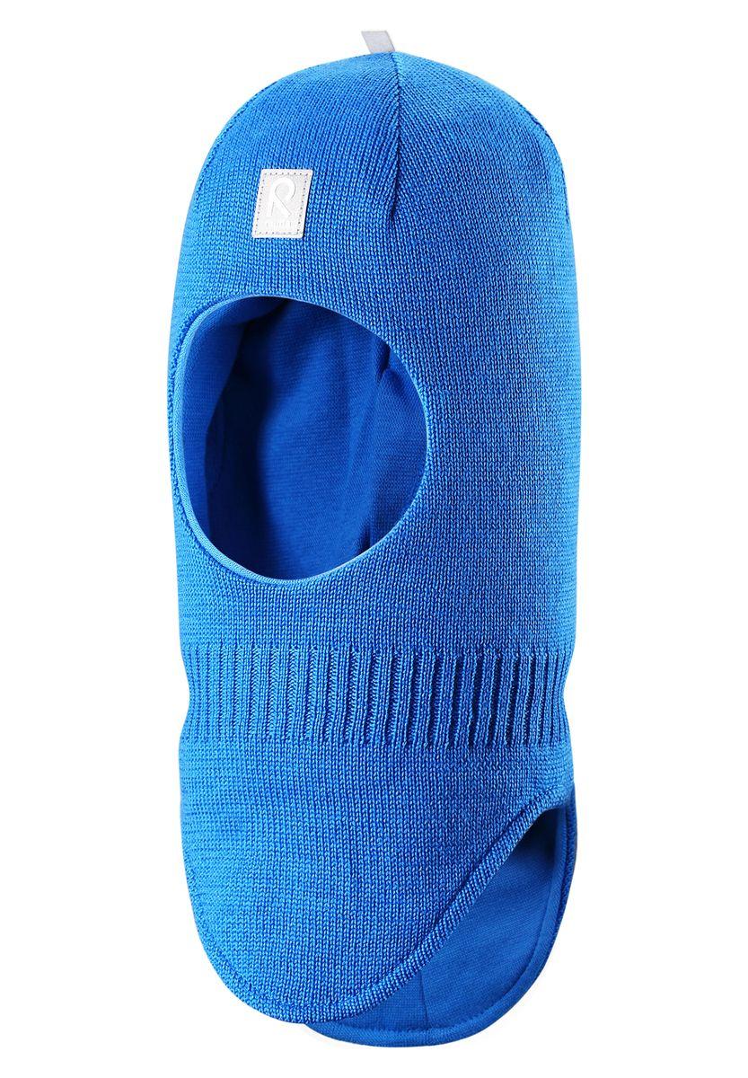 Шапка-шлем детская Starrie. 518315518315_0100Уютная детская шапка-шлем Reima Starrie идеально подойдет для прогулок в холодное время года. По своей конструкции шлем облегает голову ребенка, надежно защищая ушки, лоб и щечки от продуваний. Вязаная шапочка-шлем, выполненная из 100% шерсти на мягкой подкладке из эластичного хлопка, прекрасно сохраняет тепло и обладает отличной гигроскопичностью (не впитывает влагу, но проводит ее), она мягкая и идеально прилегает к голове. Спереди предусмотрена небольшая светоотражающая нашивка с логотипом бренда, которая не оставит вашего ребенка незамеченным в темное время суток. Оригинальный дизайн и высокое качество делают эту шапку модным и стильным предметом детского гардероба. В ней ваш ребенок будет чувствовать себя уютно и комфортно и всегда будет в центре внимания! Уважаемые клиенты! Размер, доступный для заказа, является обхватом головы.