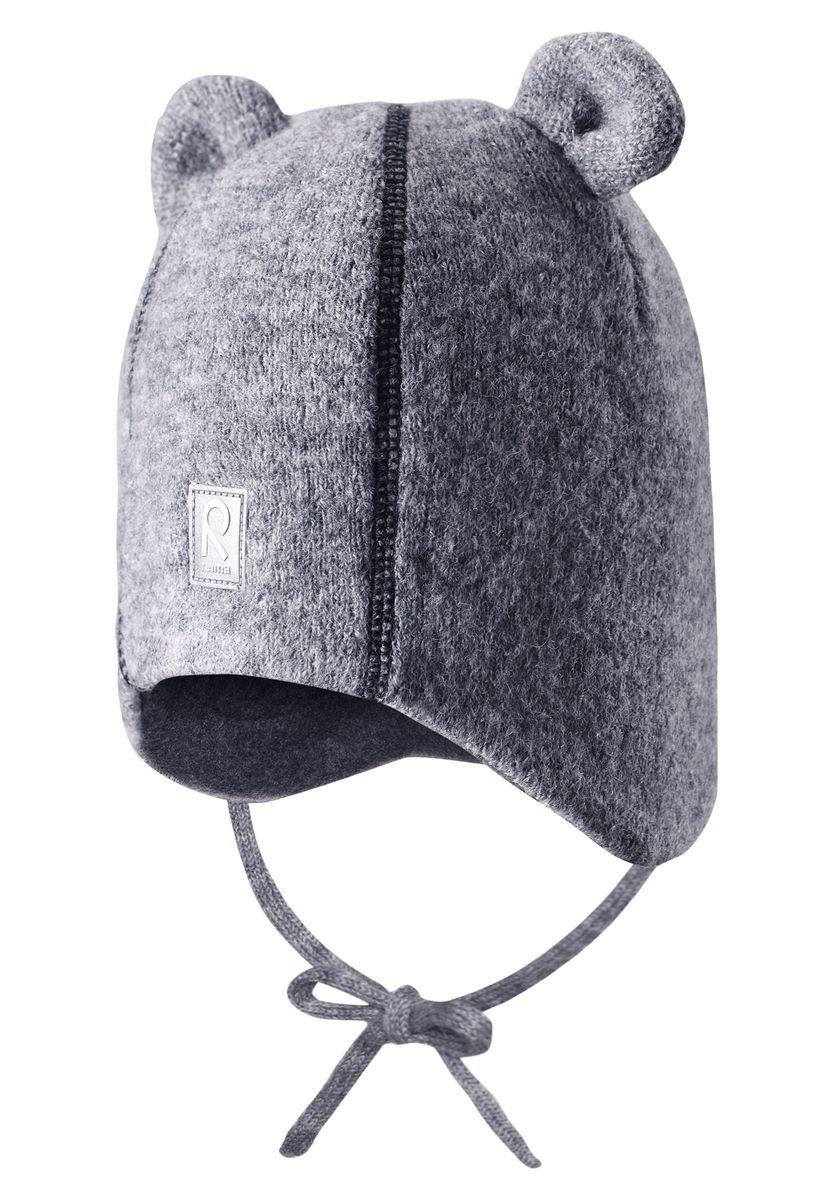 Шапка детская518357-4900Стильная и очень теплая шерстяная шапка для малышей на мягкой и удобной флисовой подкладке. Благодаря очень мягкому полярному флису голова малыша будет в тепле и не вспотеет, сколько ни бегай. Ветронепроницаемые вставки в области ушей защищают ушки от холодного ветра, а благодаря завязкам, шапка точно не собьётся во время веселых прогулок. Забавные «ушки» и декоративная строчка придают этой супер теплой модели завершающий штрих!