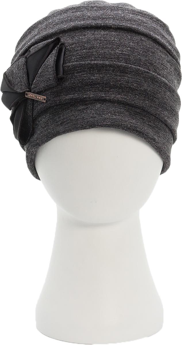 Шапка женская. 9943_бант994348Стильная женская шапка Level Pro дополнит ваш наряд и не позволит вам замерзнуть в холодное время года. Шапка наполовину выполнена из шерсти с добавлением полиэстера , что позволяет ей великолепно сохранять тепло и обеспечивает высокую эластичность и удобство посадки. Внутренняя сторона модели флисовая. Изделие оформлено оригинальными тканевыми прострочками и принтом цветочка. Дополнена модель металлической пластиной с названием бренда. Такая шапка составит идеальный комплект с модной верхней одеждой, в ней вам будет уютно и тепло.