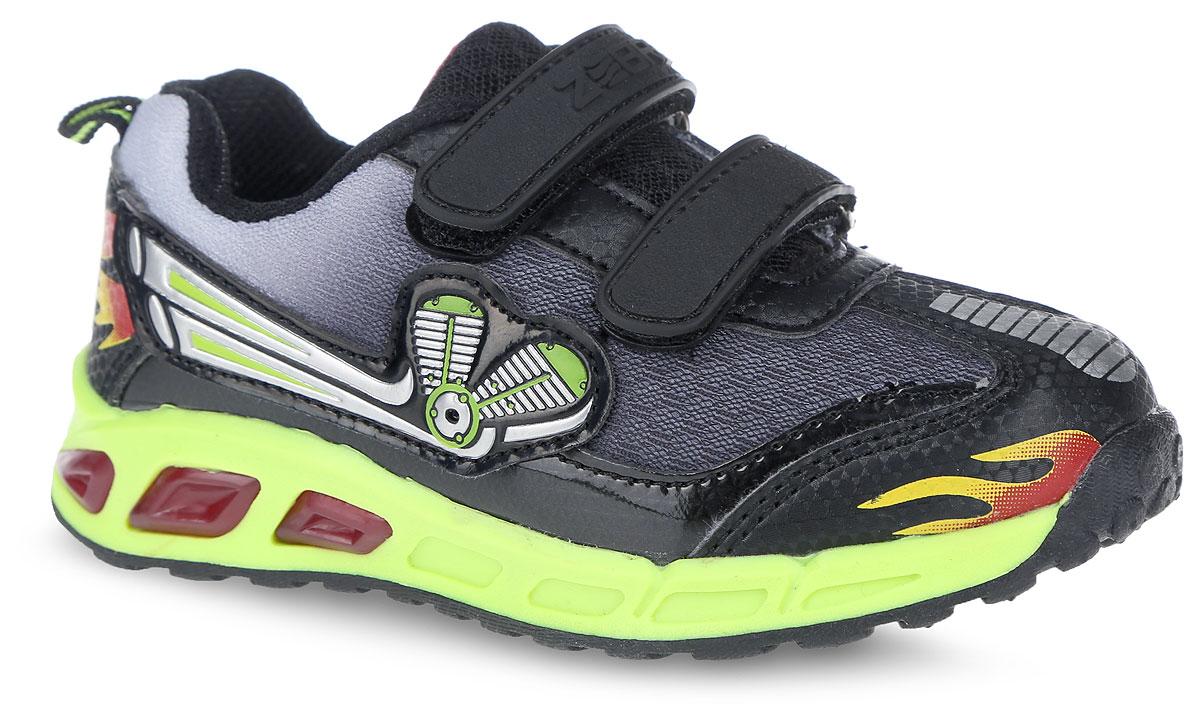 Кроссовки для мальчика. 10869-1/10871-510869-1Модные кроссовки от фирмы Зебра займут достойное место среди коллекции обуви вашего мальчика! Обувь декорирована яркой аппликацией, а также оснащена подошвой, светящейся при ходьбе. Два ремешка на застежках-липучках надежно фиксируют изделие на ноге. Стелька из ЭВА материала обеспечивает амортизацию при движении и максимальную устойчивость, снижает общую утомляемость ног. Супинатор на стельке предотвращает развитие плоскостопия. Подошва с протектором гарантирует отличное сцепление с любыми поверхностями. Удобные кроссовки - незаменимая вещь в гардеробе каждого ребенка.