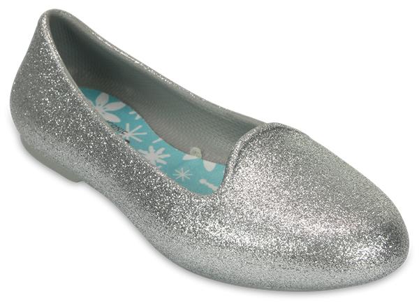203521-001Стильные балетки для девочки Eve Sparkle Flat от Crocs созданы специально для маленьких модниц. Изящная форма носка и линии верха будут отлично сочетаться с любым нарядом. Модель выполнена из полимера Croslite. Благодаря материалу Croslite обувь невероятно легкая, мягкая и удобная. Материал Croslite - бактериостатичен, препятствует появлению неприятных запахов и легок в уходе: быстро сохнет и не оставляет следов на любых поверхностях. Балетки оформлены блестками