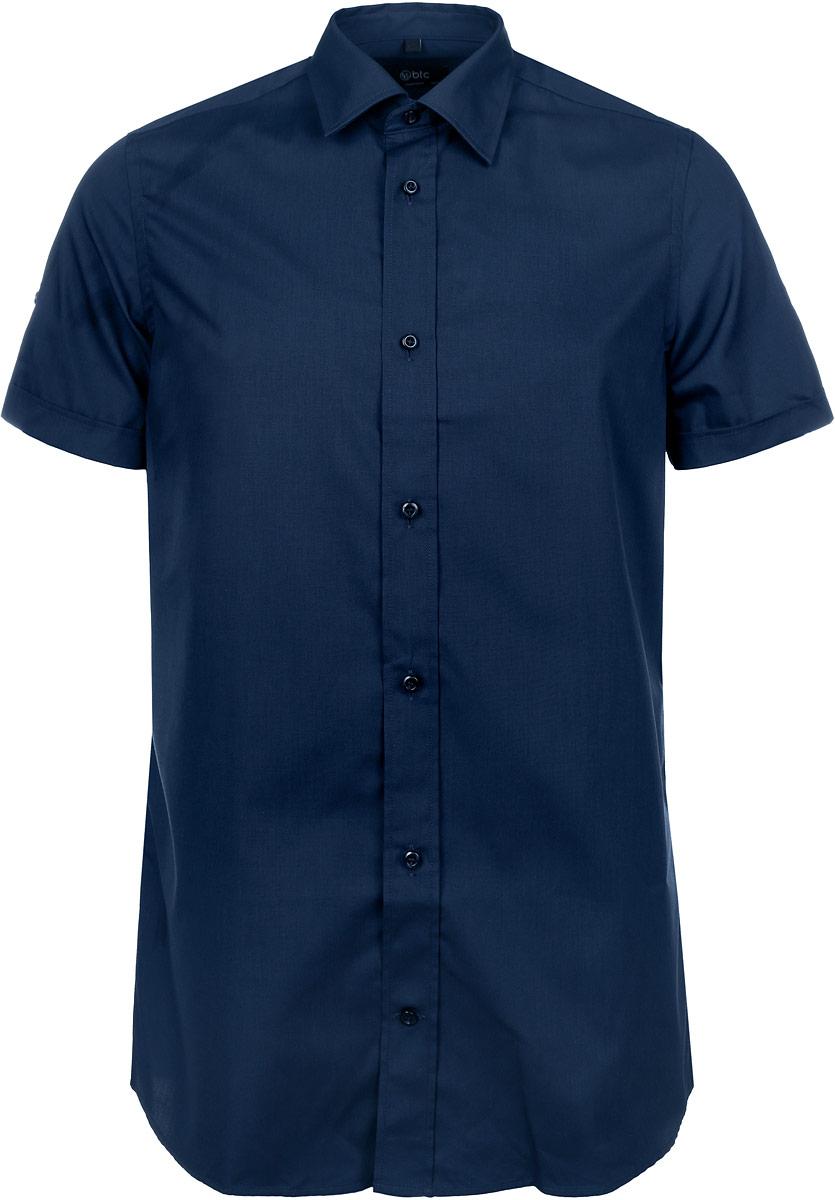 Рубашка12.015102Мужская рубашка BTC, выполненная из высококачественного материала, станет стильным дополнением к вашему гардеробу. Изделие тактильно приятное, не сковывает движений и хорошо пропускает воздух, обеспечивая комфорт при носке. Модель с отложным воротником и короткими рукавами застегивается спереди на пуговицы. Рубашка имеет слегка приталенный силуэт. Рукава дополнены декоративными отворотами и хлястиками на пуговицах. Такая рубашка подчеркнет ваш вкус и поможет создать отличный современный образ!