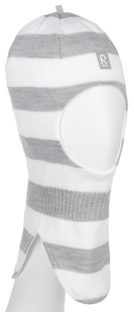 Балаклава детская518315_0100Уютная детская шапка-шлем Reima Starrie идеально подойдет для прогулок в холодное время года. По своей конструкции шлем облегает голову ребенка, надежно защищая ушки, лоб и щечки от продуваний. Вязаная шапочка-шлем, выполненная из 100% шерсти на мягкой подкладке из эластичного хлопка, прекрасно сохраняет тепло и обладает отличной гигроскопичностью (не впитывает влагу, но проводит ее), она мягкая и идеально прилегает к голове. Спереди предусмотрена небольшая светоотражающая нашивка с логотипом бренда, которая не оставит вашего ребенка незамеченным в темное время суток. Оригинальный дизайн и высокое качество делают эту шапку модным и стильным предметом детского гардероба. В ней ваш ребенок будет чувствовать себя уютно и комфортно и всегда будет в центре внимания! Уважаемые клиенты! Размер, доступный для заказа, является обхватом головы.