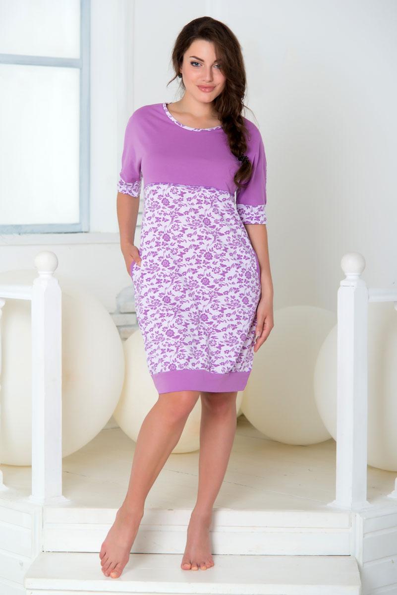 ПлатьеSS16-PL-08Домашнее платье Santi выполнено из натурального хлопка. Платье-миди с круглым вырезом горловины и короткими цельнокроеными рукавами. Низ рукавов и низ модели дополнены эластичными манжетами. Платье оформлено цветочным принтом.