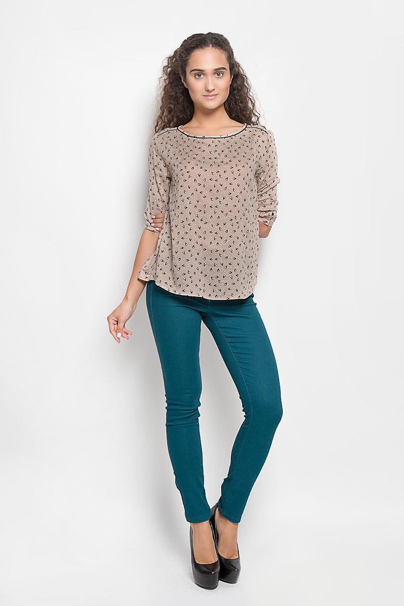 БлузкаTw-112/1078-6372Стильная женская блуза Sela, выполненная из 100% вискозы, подчеркнет ваш уникальный стиль и поможет создать оригинальный женственный образ. Блузка с удлиненной спинкой, рукавами 3/4 и круглым вырезом горловины застегивается на пуговицу сзади, манжеты рукавов также застегиваются на пуговицы. Блузка оформлена оригинальным орнаментом. Такая блузка идеально подойдет для жарких летних дней. Эта блузка будет дарить вам комфорт в течение всего дня и послужит замечательным дополнением к вашему гардеробу.