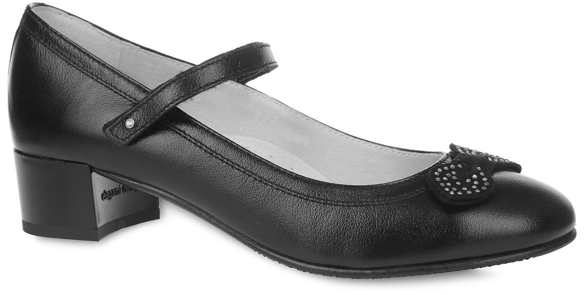 Туфли для девочки. 3/4-5189716023/4-518971602Прелестные туфли от фирмы Elegami понравятся вашей юной моднице с первого взгляда. Верх и подкладка модели выполнены из натуральной кожи, что гарантируют комфорт и уют. Ремешок на застежке-липучке надежно зафиксирует изделие на ноге. Мыс декорирован замшевым бантом, украшенным стразами. Стелька дополнена супинатором, который обеспечивает правильное положение ноги ребенка при ходьбе, предотвращает плоскостопие. Подошва, выполненная из ТЭП-материала, оснащена рифлением для лучшего сцепления с различными поверхностями. Стильные и удобные туфли - незаменимая вещь в гардеробе каждой школьницы.
