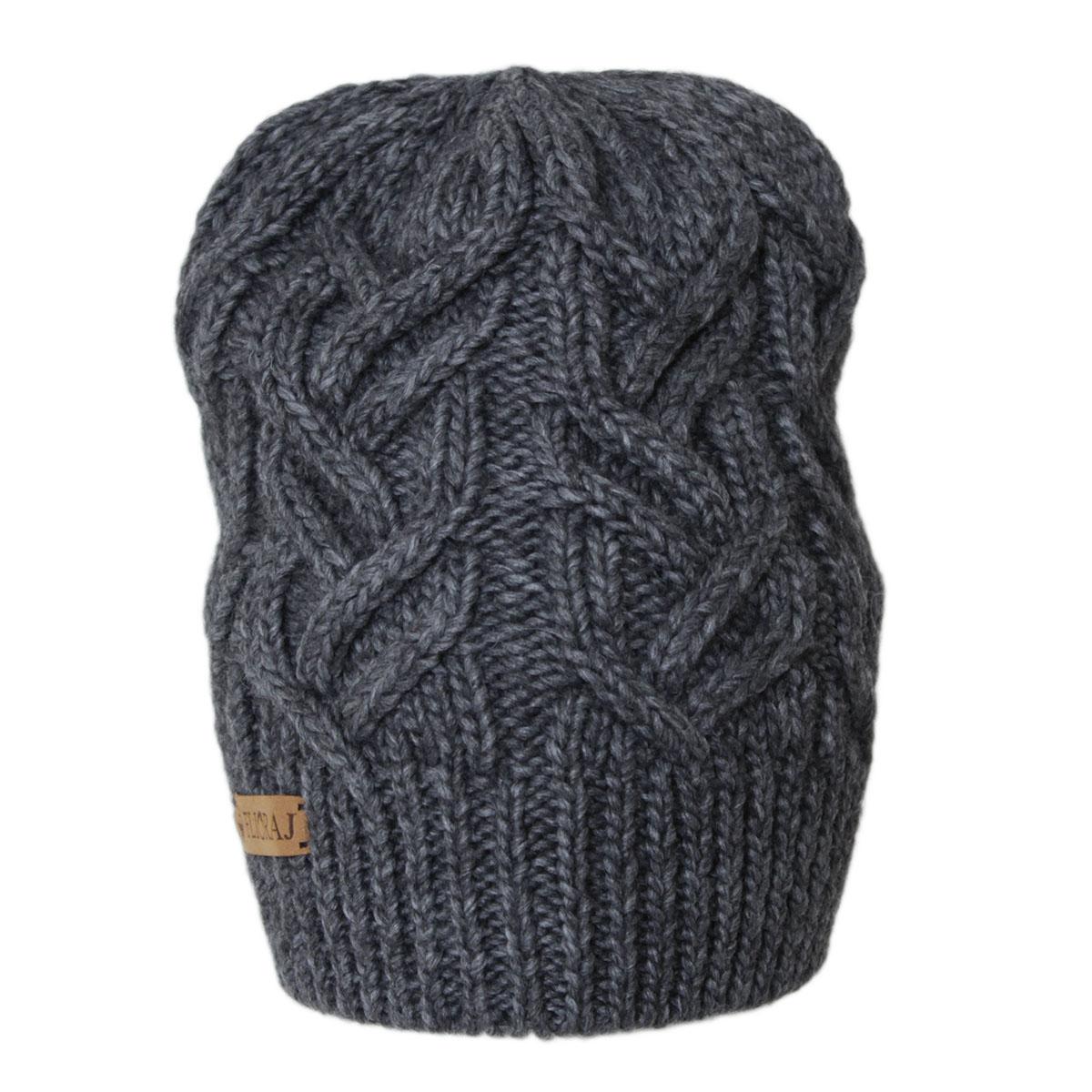 Шапка женская. 307FJ307FJТеплая шапка связанная из объемной итальянской пряжи, украшена ажурными модными косами и нашивкой из натуральной кожи. Выполнена модной рельефной вязкой. Отлично защитит от холода.