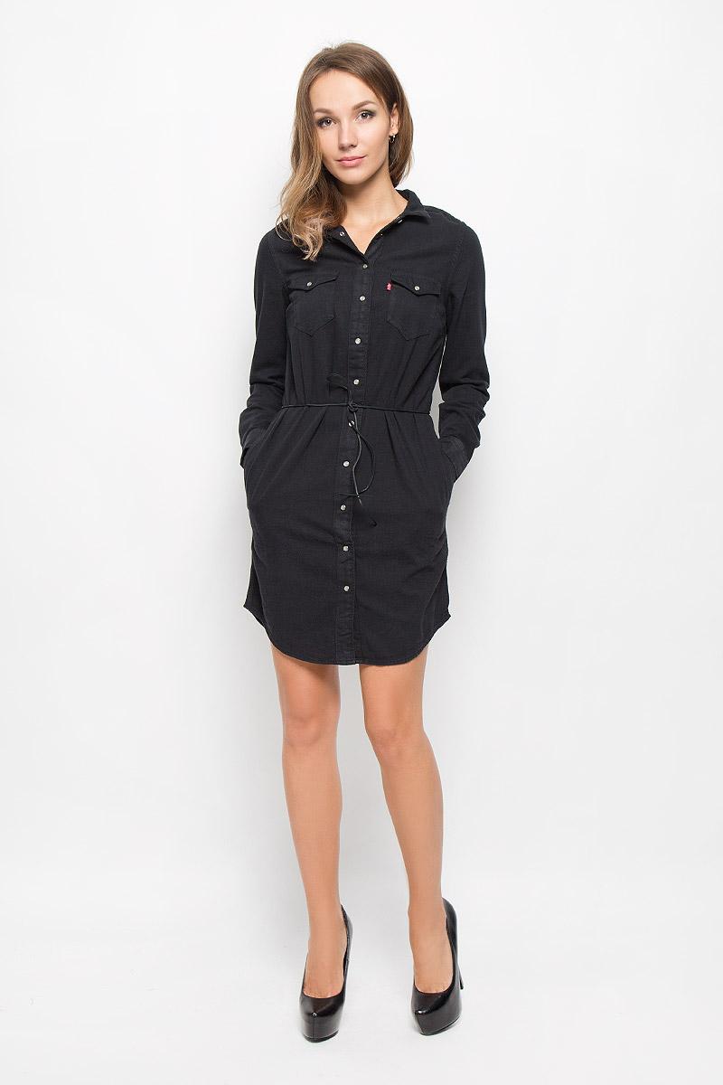 1929200000Платье Levis®, выполненное по мотивам классической рубашки Western shirt, станет стильным дополнением к вашему гардеробу. Изготовленное из натурального хлопка, оно очень приятное на ощупь, не сковывает движений и позволяет коже дышать. Платье-рубашка с длинными рукавами и отложным воротником застегивается на кнопки и пуговицу. На манжетах предусмотрены застежки-кнопки. На груди расположены два накладных кармана с клапанами на кнопках, в боковых швах - два втачных кармана. Модель дополнена узким поясом в виде кожаного шнурка. Такое платье поможет создать яркий и привлекательный образ, в нем вам будет удобно и комфортно.