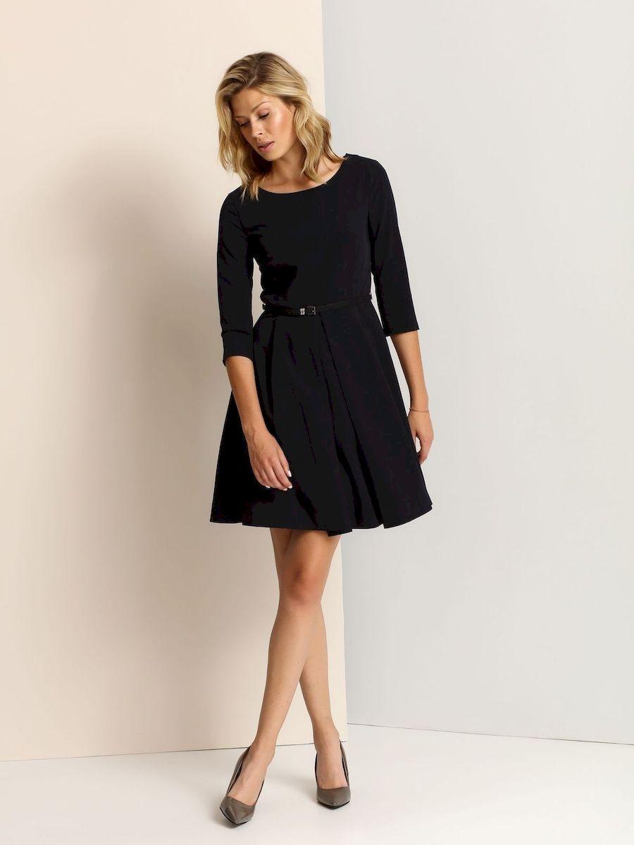 SSU1654GRСтильное платье Top Secret выполнено из полиэстера и вискозы с добавлением эластана. Платье-миди А-силуэта с круглым вырезом горловины и рукавами 3/4 застегивается на скрытую застежку-молнию, расположенную на спинке. Платье дополнено стильным ремнем с металлической пряжкой.