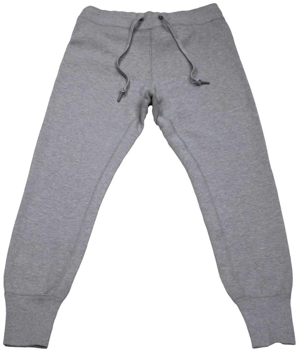 Брюки спортивные10001020001Удобные женские спортивные брюки Converse, выполненные из натурального хлопка, великолепно подойдут для отдыха, повседневной носки, а также для занятий спортом. Модель средней посадки имеет широкую эластичную резинку на поясе, объем талии регулируется при помощи шнурка-кулиски. Низ брючин дополнен широкими манжетами.