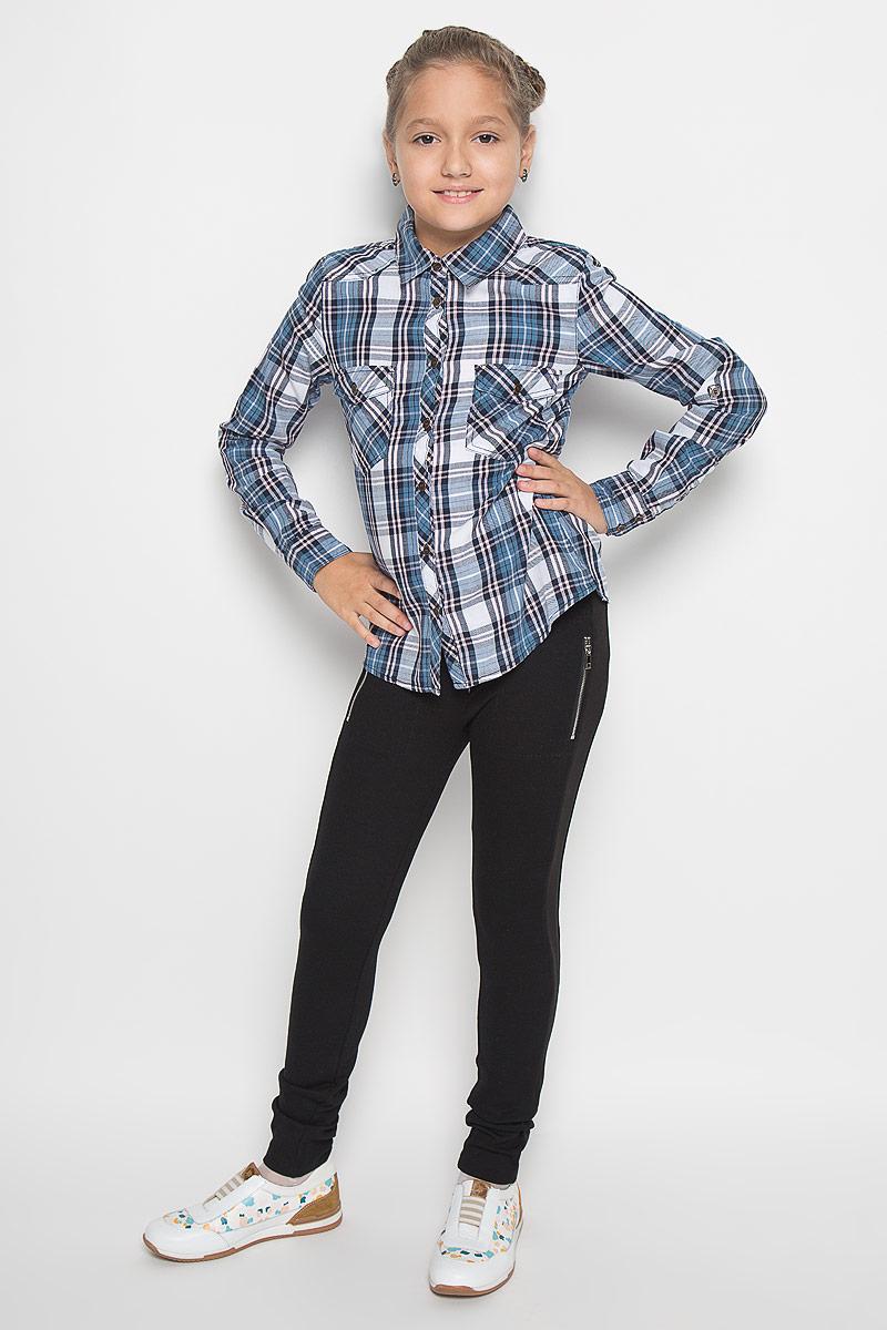B-612/840-6414Рубашка для девочки Sela, выполненная из натурального хлопка, идеально подойдет для повседневной носки. Материал изделия очень мягкий, приятный на ощупь, не стесняет движений и позволяет коже дышать. Рубашка с отложным воротником и длинными рукавами застегивается на пуговицы по всей длине. На манжетах предусмотрены застежки-пуговицы. Длину рукавов можно изменить при помощи хлястиков с пуговицами. На груди расположены накладные карманы, которые закрываются с помощью клапанов с пуговицами. Рубашка оформлена принтом в клетку. Такая рубашка поможет создать стильный образ, а также подарит ребенку комфорт в течение всего дня!