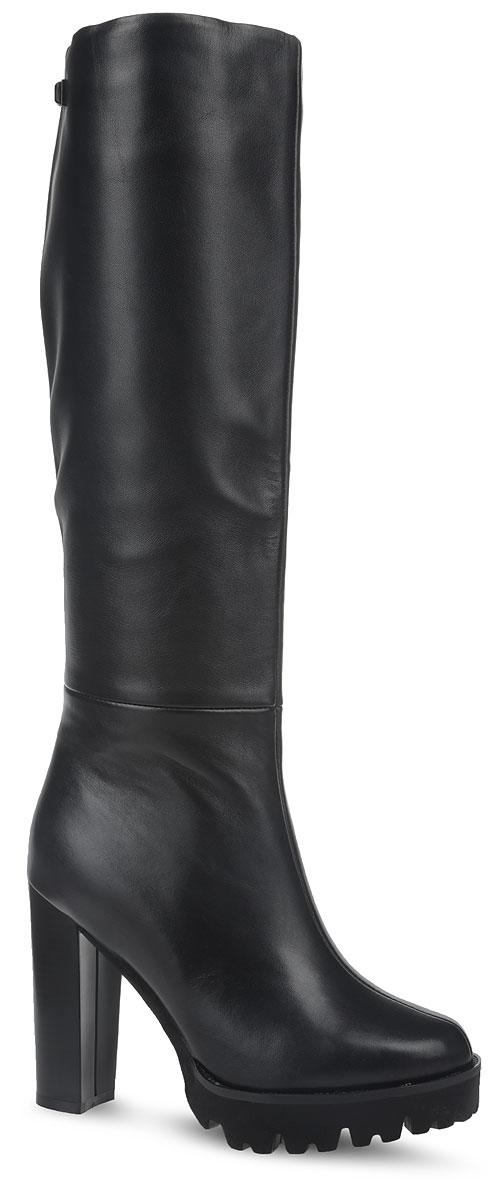 62107-0RLSСапоги от Sinta Gamma выполнены из натуральной кожи. Модель оформлена потайной эластичной резинкой на голенище, боковая часть дополнена молнией, что позволит надежно зафиксировать изделие на ноге. Внутренняя поверхность и стелька изготовлены из байки, сохраняющей тепло и создающей комфорт. Массивная подошва и устойчивый каблук выполнены из прочного материала, обеспечивающего длительную носку и хорошее сцепление с любой поверхностью. В таких сапогах вашим ногам будет тепло и уютно.