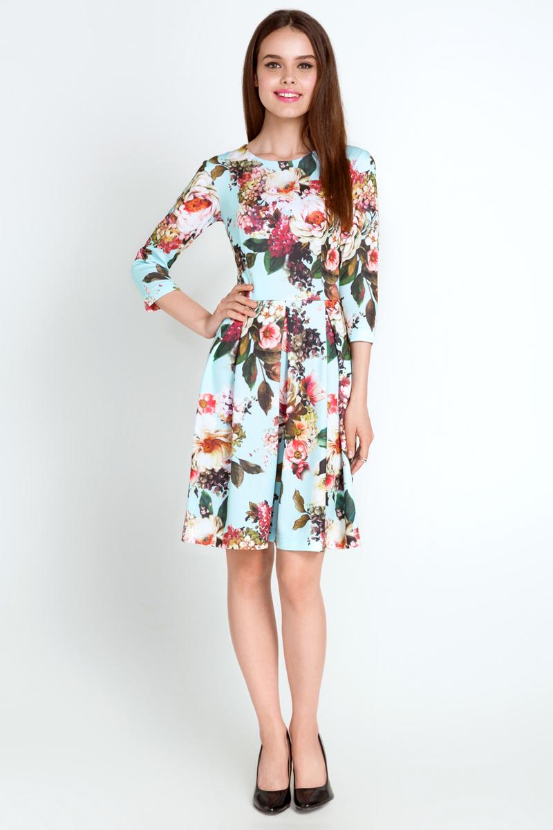 10200200180_400Стильное платье Concept Club выполнено из высококачественного материала в сочетании полиэстера и эластана. Модель-миди с круглым вырезом горловины и рукавами 1/2 застегивается сзади по спинке на потайную молнию. Оформлено платье ярким цветочным принтом, а в поясе дополнено складочками, которые придают юбке дополнительную пышность.