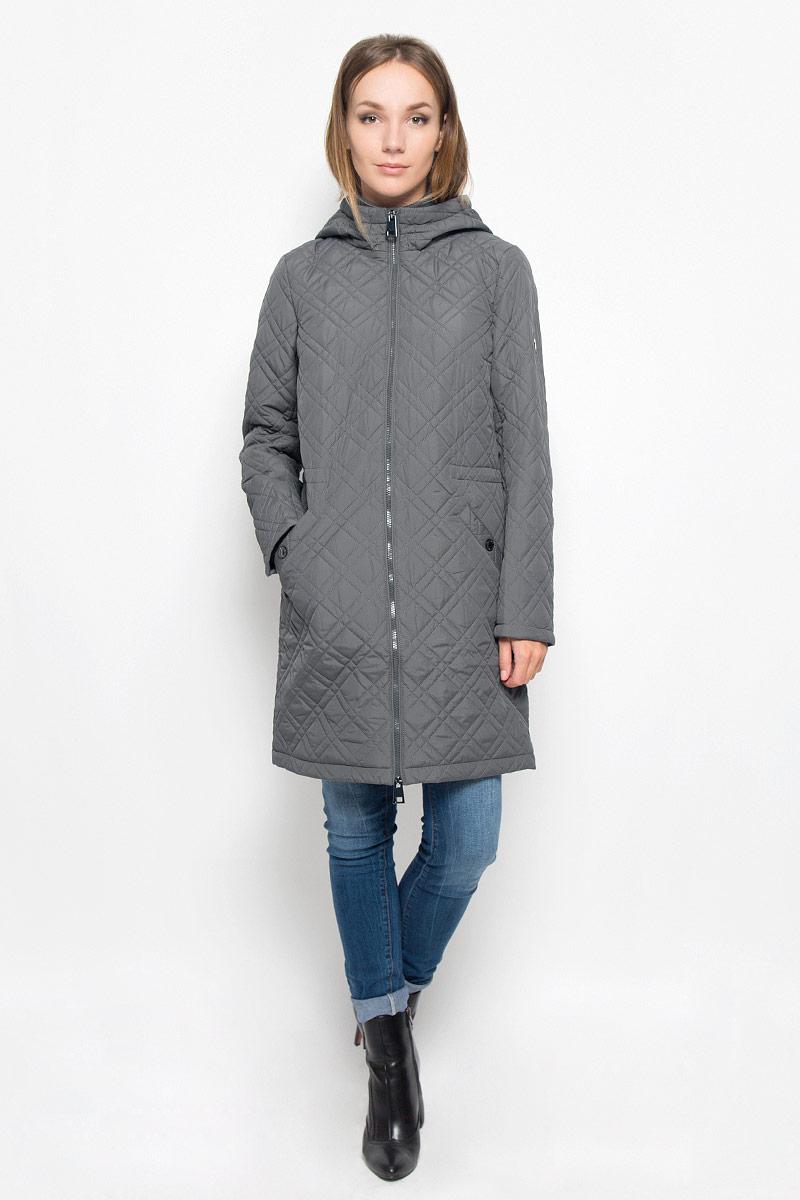A16-170000_826Стеганое женское пальто Finn Flare согреет вас в прохладную погоду и позволит выделиться из толпы. Модель с длинными рукавами, воротником-стойкой и не отстегивающимся капюшоном выполнена из прочного материала, застегивается на молнию спереди. Объем капюшона регулируется при помощи шнурка-кулиски со стопперами. Изделие дополнено двумя втачными карманами на застежках-кнопках. На талии пальто дополнено скрытым шнурком-кулиской. Наполнитель из синтепона надежно сохранит тепло, благодаря чему такое пальто защитит вас от ветра и холода. Это модное и в то же время комфортное пальто - отличный вариант для прогулок, оно подчеркнет ваш изысканный вкус и поможет создать неповторимый образ.