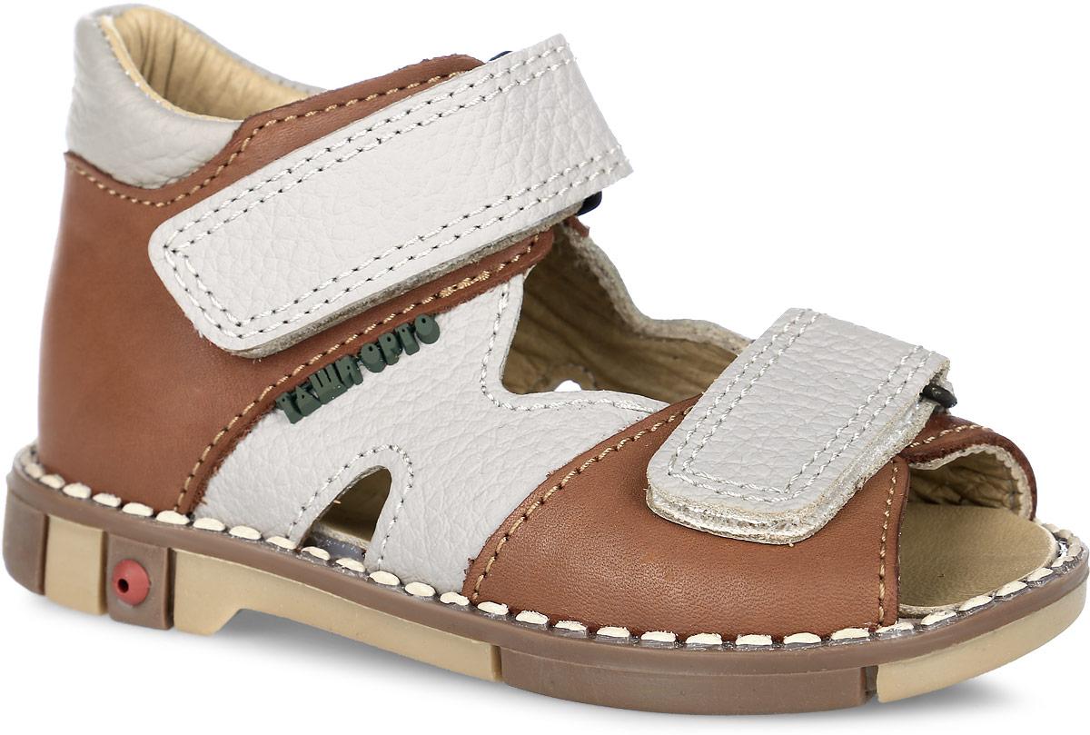 Tas260-033Стильные детские сандалии Таши Орто заинтересуют вашего ребенка с первого взгляда. Модель выполнена из натуральной кожи контрастных цветов. Ремешки на застежке-липучке помогают оптимально подогнать полноту обуви по ноге и гарантируют надежную фиксацию. Благодаря такой застежке ребенок может самостоятельно надевать обувь. Сбоку сандалии декорированы символикой бренда. Анатомическая стелька из натуральной кожи с супинатором, не продавливающимся во время носки, обеспечивает правильное формирование стопы. Благодаря использованию современных внутренних материалов оптимально распределяется нагрузка по всей площади стопы, что дает ножке ощущение мягкости и комфорта. Полужесткий задник фиксирует ножку ребенка. Мягкая верхняя часть, которая плотно прилегает к ноге, и подкладка, изготовленная из натуральной кожи, позволяют избежать натирания. У изделия ортопедический каблук Томаса высотой от 2 до 5 мм (в зависимости от размера обуви), продленный с внутренней стороны подошвы, его внутренняя...