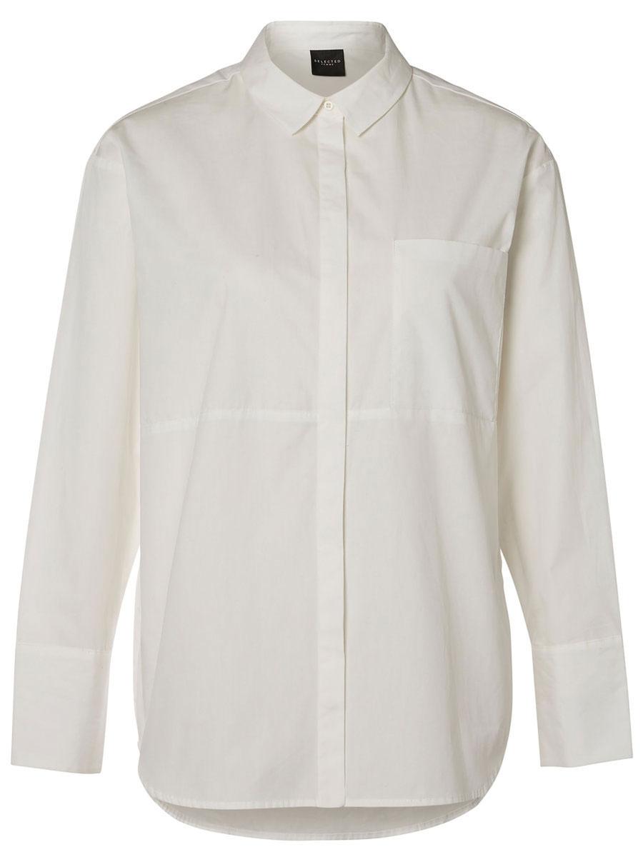 Рубашка16052017_Snow WhiteЖенская рубашка Selected Femme выполнена из натурального хлопка. Рубашка с длинными рукавами и отложным воротником застегивается на потайные пуговицы спереди. Манжеты рукавов также застегиваются на пуговицы. На груди расположен накладной карман.