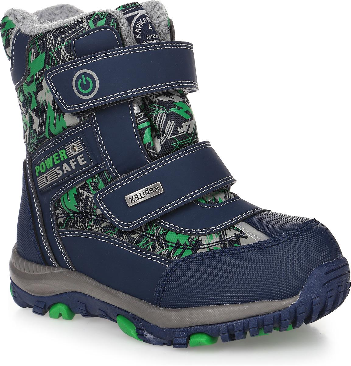 42187-1Ботинки от Kapika придутся по душе вашему мальчику. Модель идеально подходит для зимы, сохраняет комфортный микроклимат в обуви как при ношении на улице, так и в помещении. Верх обуви изготовлен из искусственной кожи со вставками из водонепроницаемого текстиля, оформленного абстрактным принтом, боковая сторона, язычок и верхний ремешок оформлены фирменным логотипом бренда. Два ремешка на застежке-липучке надежно зафиксируют изделие на ноге. Подкладка и стелька изготовлены из шерсти, что позволяет сохранить тепло и гарантирует уют ногам. Подошва с рифлением обеспечивает идеальное сцепление с любыми поверхностями. Такие чудесные ботинки займут достойное место в гардеробе вашего ребенка.