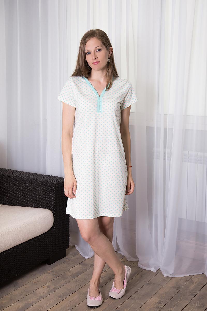 7117110721Домашнее платье Violett выполнено из натурального хлопка. Платье-миди свободного кроя с V-образным вырезом горловины и короткими рукавами оформлено принтом в горох, спереди - декоративными пуговицами.