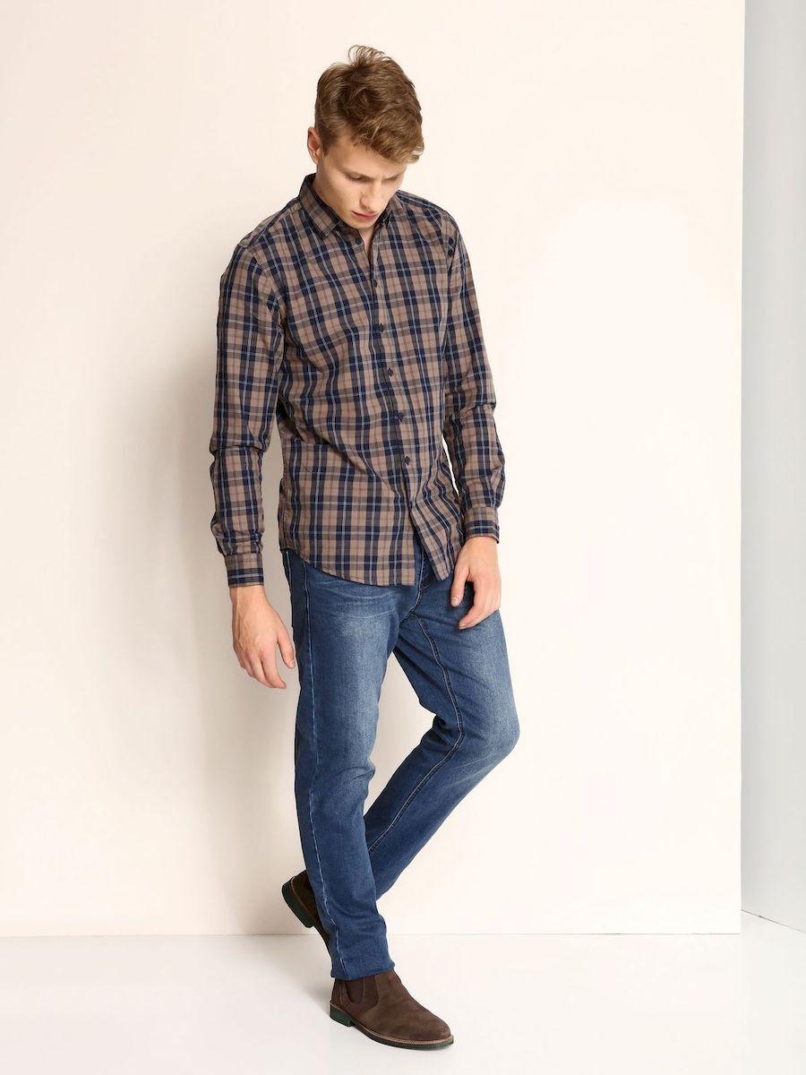 SKL2099BEСтильная мужская рубашка Wrangler, выполненная из 100% хлопка, подчеркнет ваш уникальный стиль и поможет создать оригинальный образ. Рубашка с длинными рукавами и отложным воротником застегивается на пуговицы спереди. Рукава рубашки дополнены манжетами, которые также застегиваются на пуговицы. Модель выполнена стильным принтом в клетку.