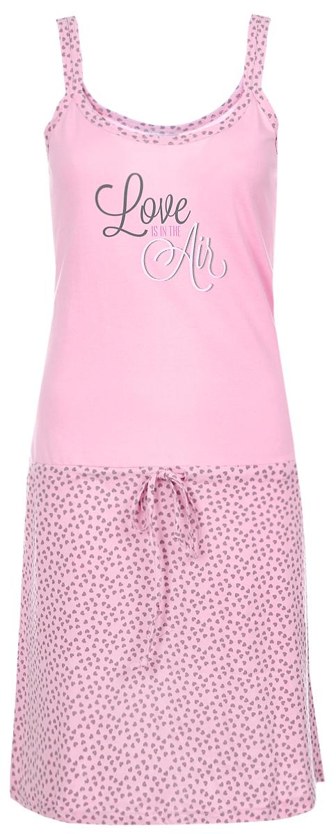 Ночная рубашка7117110326Ночная сорочка Violett, выполненная из натурального хлопка, необычайно мягкая и приятная на ощупь. Сорочка дополнена затягивающимся шнурком. Модель на тонких бретелях, оформлена надписями и интересным принтом. Домашняя одежда играет большую роль в гардеробе женщины, ведь каждой женщине хочется даже дома выглядеть привлекательной. Прекрасный вариант домашней одежды эта замечательная сорочка. В такой сорочке каждая женщина будет чувствовать себя уютно и спокойно!