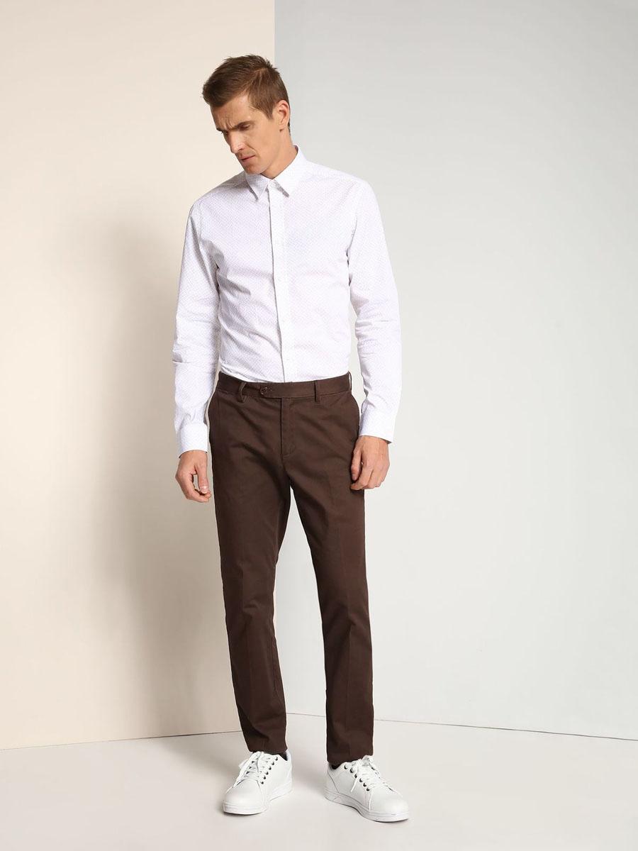 РубашкаSKL2143BIСтильная мужская рубашка Top Secret, выполнена из натурального хлопка. Модель с отложным воротником застегивается на пуговицы. Длинные рукава рубашки дополнены манжетами на пуговицах. Оформлено изделие интересным принтом.
