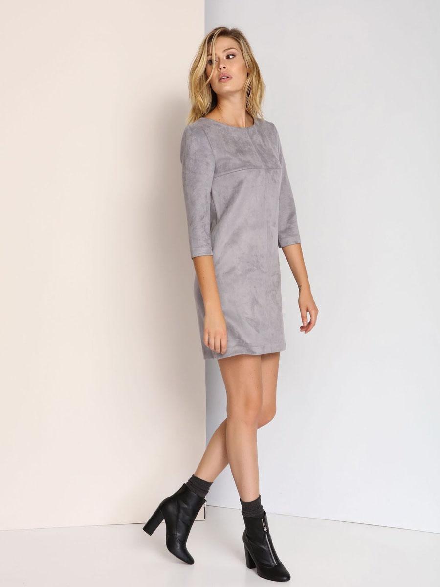 ПлатьеSSU1681GBСтильное платье Top Secret выполнено из полиэстера с добавлением эластана. Модель с круглым вырезом горловины и рукавами 3/4. Платье прямого кроя на спинке застегивается на скрытую застежку-молнию.