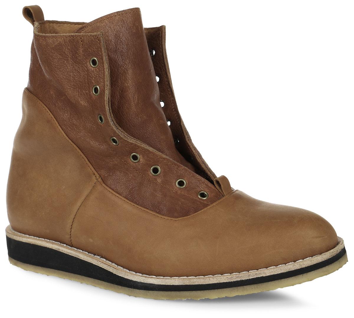 Brink-bСтильные ботинки от Notmysize заинтересуют вас своим дизайном. Модель выполнена из натуральной кожи с утеплителем из шерсти. Ботинки с вшитым язычком, дополнены металлическими люверсами. Ярлычок на заднике облегчает надевание обуви. Шерстяная стелька обеспечит комфорт при ходьбе. Каблук и подошва с рифлением защищают изделие от скольжения. Модные ботинки подчеркнут ваш стиль и индивидуальность.