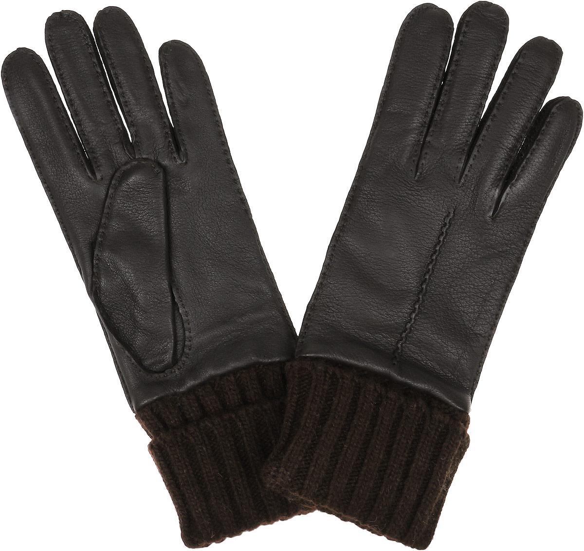 Перчатки2.41-1 blackСтильные женские перчатки Fabretti не только защитят ваши руки, но и станут великолепным украшением. Перчатки выполнены из чрезвычайно мягкой и приятной на ощупь эфиопской перчаточной кожи, а их подкладка - из шерсти с добавлением кашемира. Модель дополнена вязаными манжетами и оформлена фактурным тиснением. Строчки-стежки придают перчаткам динамичное настроение. Стильный аксессуар для повседневного образа.