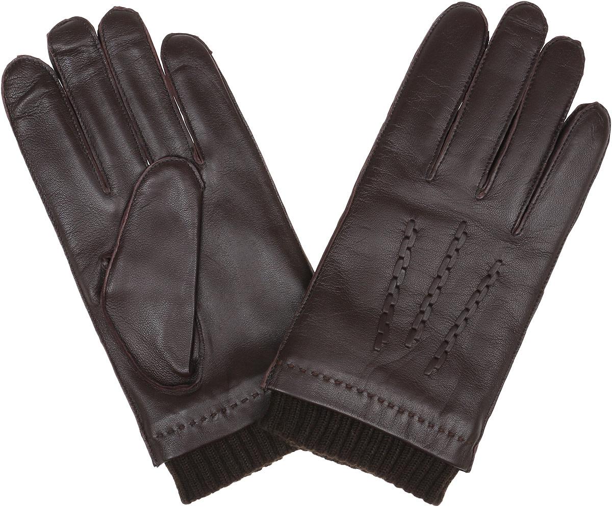 12.49-2 chocolateСтильные мужские перчатки Fabretti не только защитят ваши руки, но и станут великолепным украшением. Перчатки выполнены из натуральной кожи ягненка, а их подкладка - из высококачественной шерсти с добавлением кашемира. Модель дополнена декоративными швами в виде трех лучей. Перчатки оформлены манжетной резинкой. Стильный аксессуар для повседневного образа.