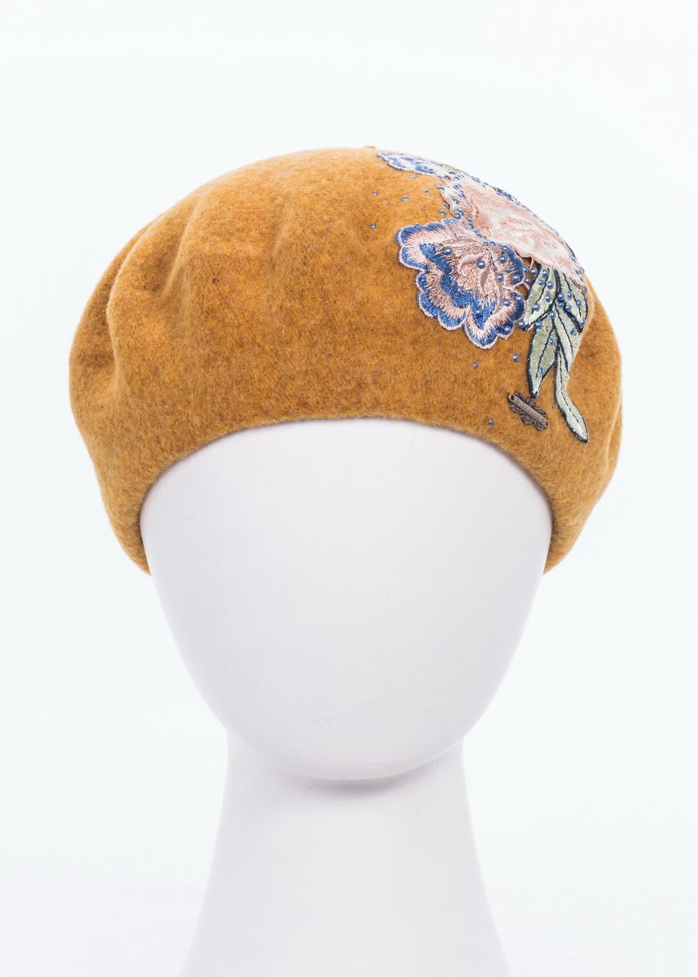 Берет992934Теплый берет Avanta Mirella, выполненный из натуральной шерсти, отлично дополнит ваш образ в холодную погоду. Модель оформлена оригинальной нашивкой из цветов и стразами. Такой берет, составит идеальный комплект с модной верхней одеждой, в нем вам будет уютно и тепло! Уважаемые клиенты! Размер, доступный для заказа, является обхватом головы.