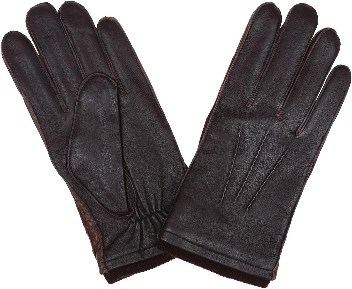 Перчатки12.48-1 blackСтильные мужские перчатки Fabretti не только защитят ваши руки, но и станут великолепным украшением. Перчатки выполнены из натуральной кожи ягненка, а их подкладка - из высококачественной шерсти с добавлением кашемира. Модель дополнена декоративными швами в виде трех лучей. Перчатки имеют строчки- стежки на запястье, которые придают большее удобство при носке. Стильный аксессуар для повседневного образа.