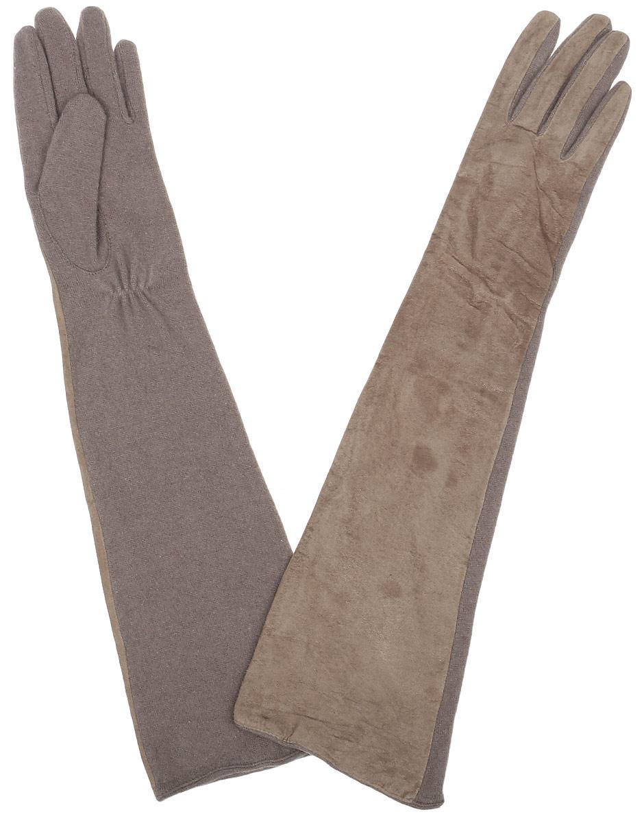 23.1-1_blackЭлегантные удлиненные женские перчатки Fabretti станут великолепным дополнением вашего образа и защитят ваши руки от холода и ветра во время прогулок. Лицевая сторона перчаток выполнена из натуральной замши, а обратная сторона из высококачественной теплой шерсти. Модель оформлена в лаконичном однотонном стиле. Такие перчатки будут оригинальным завершающим штрихом в создании современного модного образа.