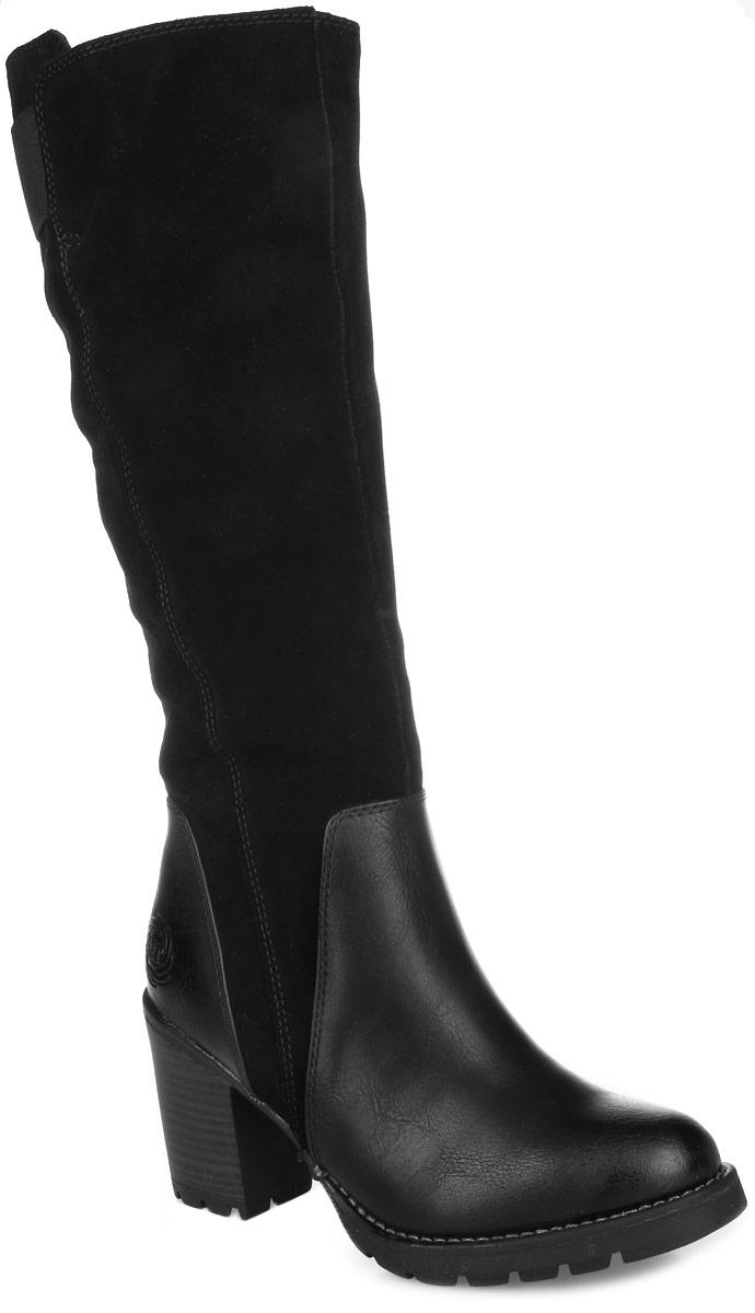 2-2-26613-27-096Стильные женские сапоги от Marco Tozzi заинтересуют вас своим дизайном с первого взгляда! Модель выполнена из высококачественной натуральной замши и кожи. Подкладка и стелька из искусственного меха защитят ноги от холода и обеспечат комфорт. Сапоги застегиваются на застежку-молнию, расположенную сбоку. Подошва и устойчивый каблук из искусственных материалов оснащены рифлением. Модные сапоги покорят вас уютом и комфортом!