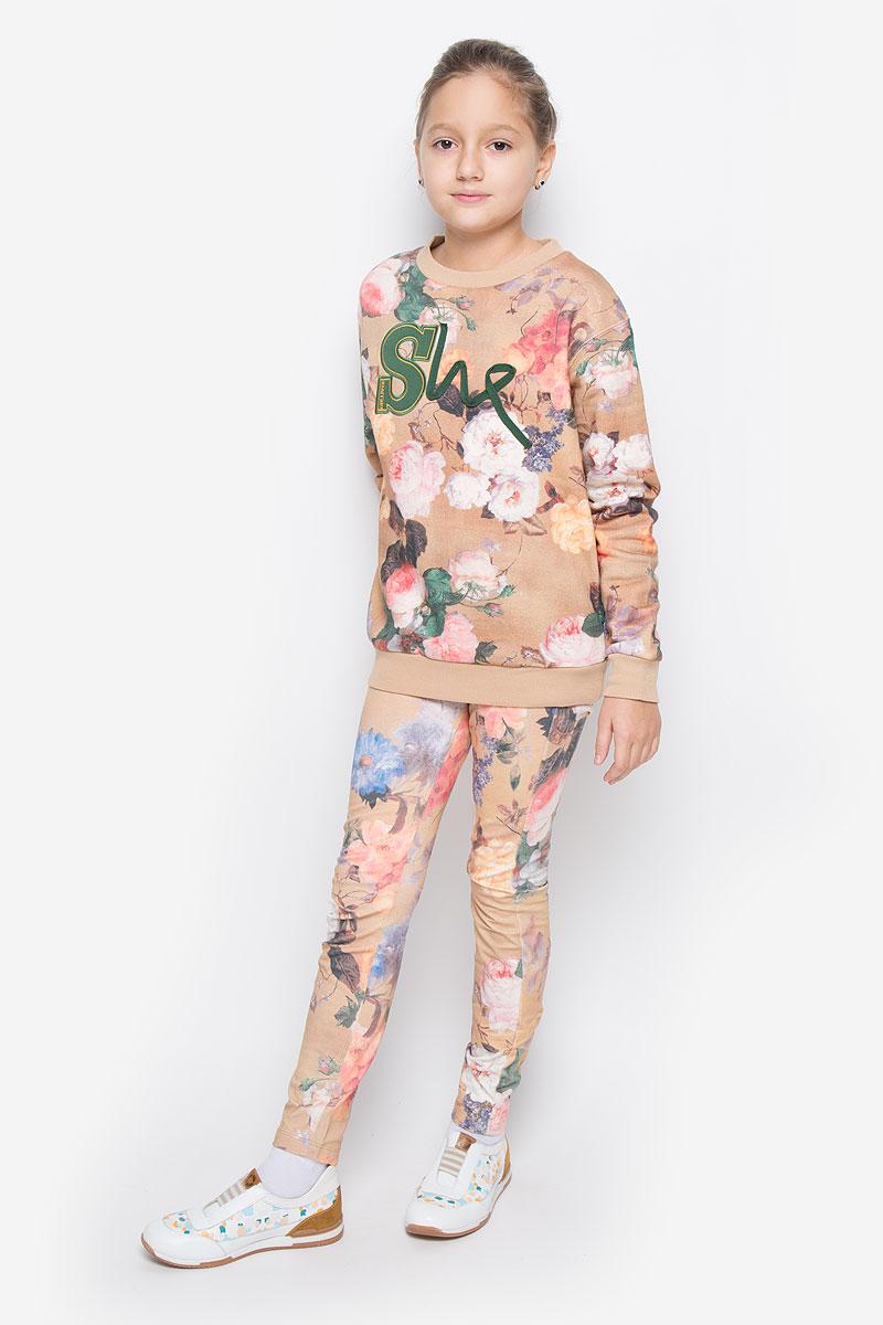 Свитшот21610GTC1601Стильный и теплый свитшот Gulliver из коллекции Осенний сад станет отличным дополнением к гардеробу вашей девочки. Свитшот, выполненный из натурального хлопка, необычайно мягкий и приятный на ощупь, не сковывает движения и позволяет коже дышать, не раздражает даже самую нежную и чувствительную кожу ребенка, обеспечивая наибольший комфорт. Свитшот с длинными рукавами и круглым вырезом горловины оформлен цветочным принтом, спереди - аппликацией. Вырез горловины, манжеты рукавов и низ модели дополнены трикотажными резинками.