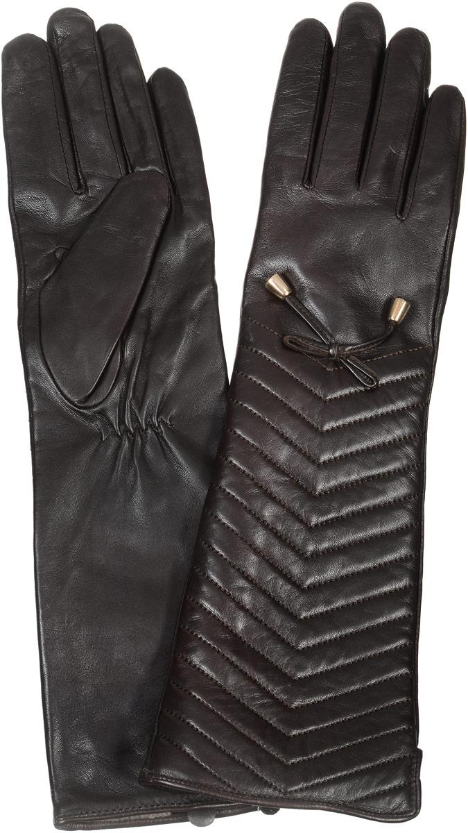 2104516682Стильные женские перчатки Piero станут великолепным дополнением вашего образа и защитят ваши руки от холода и ветра во время прогулок. Длинные перчатки выполнены из натуральной кожи, а подкладка изготовлена из теплой шерсти с добавлением акрила. Модель выполнена в лаконичном однотонном стиле и оформлена оригинальной отстрочкой на лицевой стороне изделия и бантиком с металлическими колокольчиками. Такие перчатки будут оригинальным завершающим штрихом в создании современного модного образа.