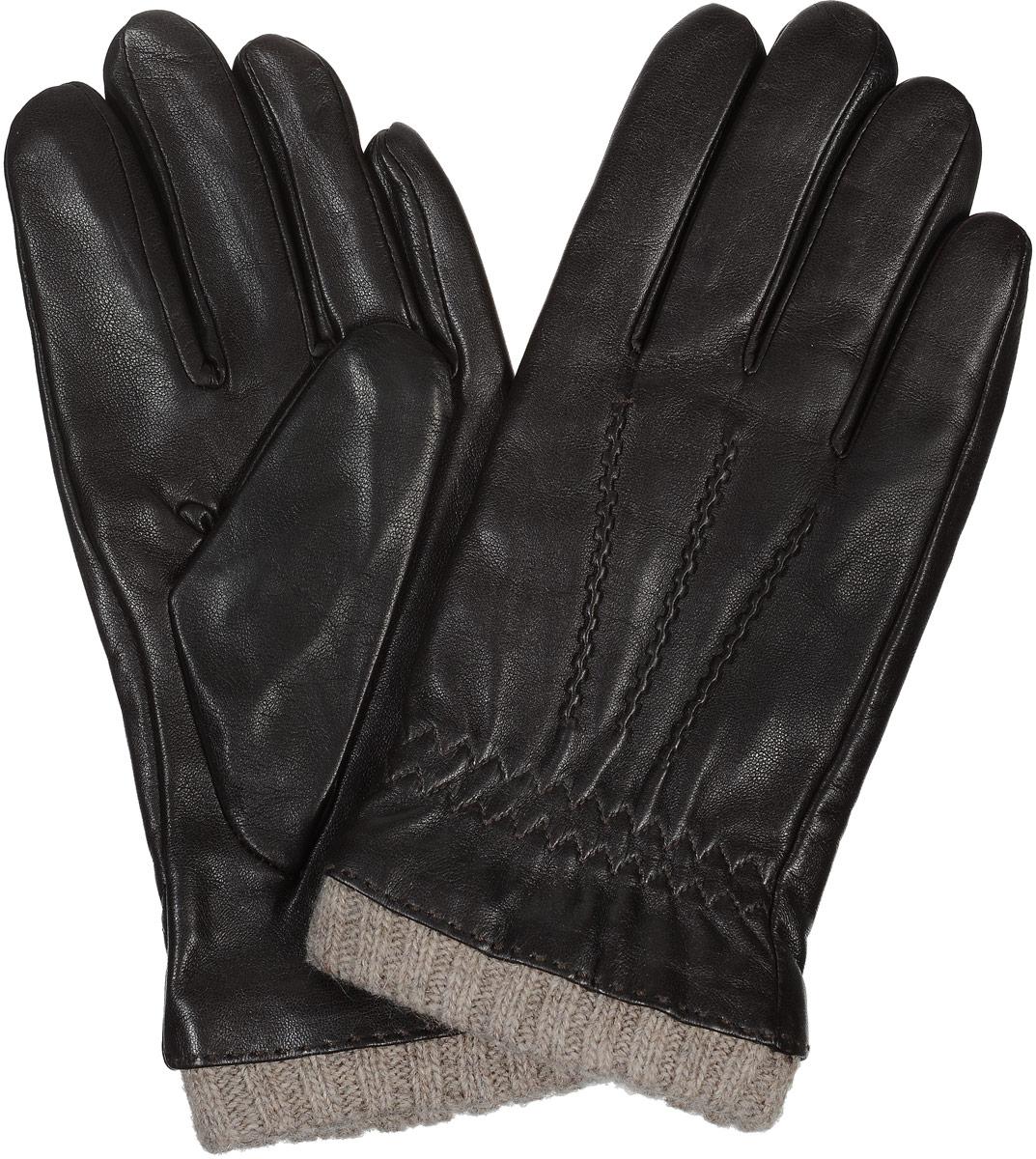 02204715387_11Стильные мужские перчатки Piero станут великолепным дополнением вашего образа и защитят ваши руки от холода и ветра во время прогулок. Перчатки выполнены из натуральной кожи, а подкладка изготовлена из теплой шерсти с добавлением кашемира. Модель выполнена в лаконичном однотонном стиле и оформлена оригинальной отстрочкой на лицевой стороне изделия. Манжет изделия дополнен вязанной резинкой. Такие перчатки будут оригинальным завершающим штрихом в создании современного модного образа.