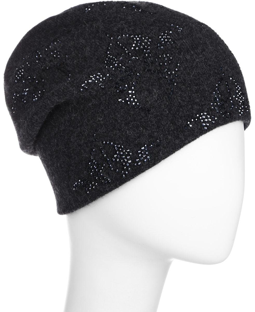 ШапкаW16-11130_204Стильная женская шапка Finn Flare дополнит ваш наряд и не позволит вам замерзнуть в холодное время года. Шапка выполнена из высококачественной пряжи, что позволяет ей великолепно сохранять тепло и обеспечивает высокую эластичность и удобство посадки. Модель оформлена брендовой металлической пластиной и узорами из стразов.