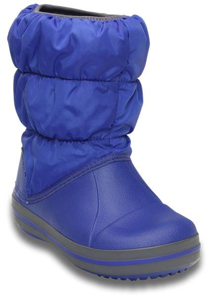 14613-6X0Детские дутики Winter Puff Boot от Crocs сохранят тепло в холодную погоду. Дутики выполнены из прочного водонепроницаемого и грязеотталкивающего текстиля и полимера Croslite. Литая непромокаемая носочная часть из материала Croslite гарантирует легкость и комфорт. Подкладка и стелька выполнены из мягкого текстиля, что обеспечит комфорт и уют ногам. Такая подкладка дышит, согревает и соответствует гигиеническим нормам. Подошва с протектором гарантирует идеальное сцепление на любой поверхности. Декоративный рант по периметру основания подошвы придает дутикам спортивный стиль. Рекомендуемый температурный режим: до -15-20С°.