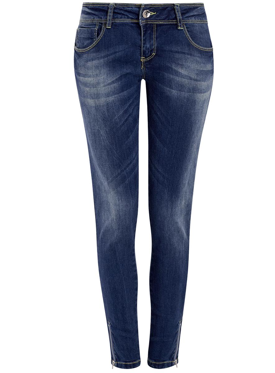 Джинсы12106040/22306/7000WЖенские джинсы oodji Denim выполнены из высококачественного эластичного хлопка. Джинсы-скинни стандартной посадки застегиваются на пуговицу в поясе и ширинку на застежке-молнии, дополнены шлевками для ремня. Джинсы имеют классический пятикарманный крой: спереди модель дополнена двумя втачными карманами и одним маленьким накладным кармашком, а сзади - двумя накладными карманами. Джинсы украшены декоративными потертостями. Брючины дополнены металлическими застежками-молниями по низу.
